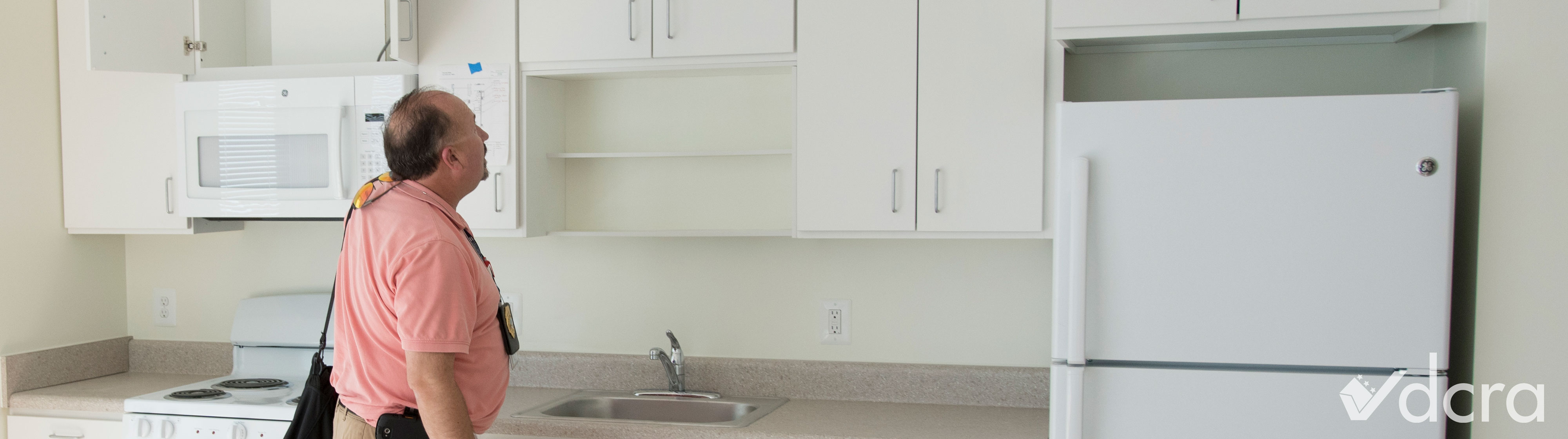 Inspector looking at a kitchen