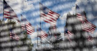 Flags reflected in Vietnam Memorial